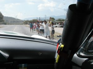 Local people cheering the Carrera Panamericana racers