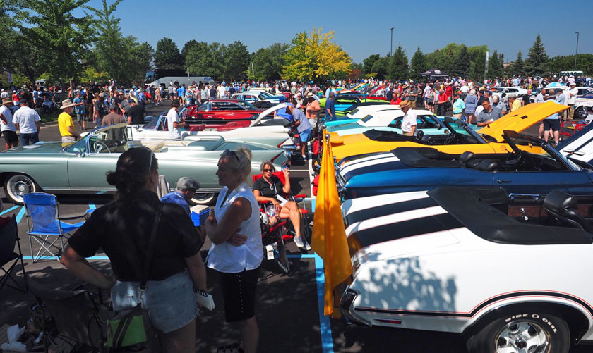 Cars crowded on parking lot.